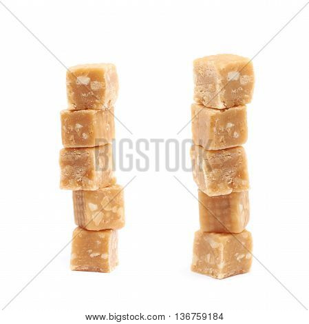 Toffee candy with nuts isolated over the white background, set of two different foreshortenings