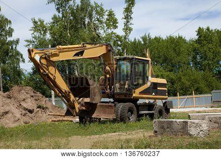 Excavator; Power Shovel; Steam Shovel; Earth-moving Mashine; Dredge Standing On The Ground