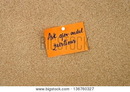 Ask Open-ended Questions Written On Orange Paper Note