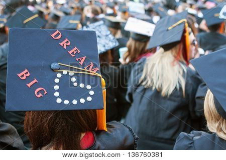 ATHENS, GA - MAY 2016: A University of Georgia graduate wears a mortarboard that says
