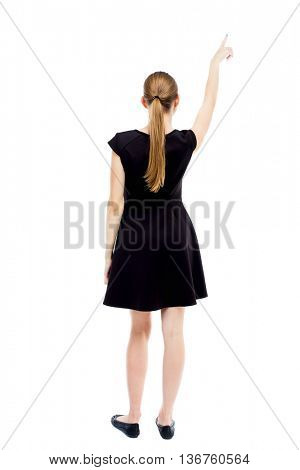 Back view of  pointing woman. beautiful girl. Rear view people collection.  backside view person. Isolated over white background. blonde in black dress pointing at something interesting in the sky