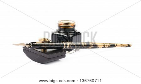 Ink writing tools composition of a blotting paper press, ink bottle and dip tip pen, isolated over the white background