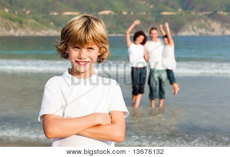 Young Family Enjoying the a stroll on the beach