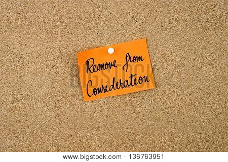 Remove From Consideration Written On Orange Paper Note