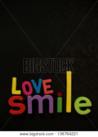 Love And Smile! Inspirational Message In Vibrant Colorful Magnet Letters