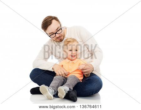 family, childhood, fatherhood, leisure and people concept - happy father and and little son