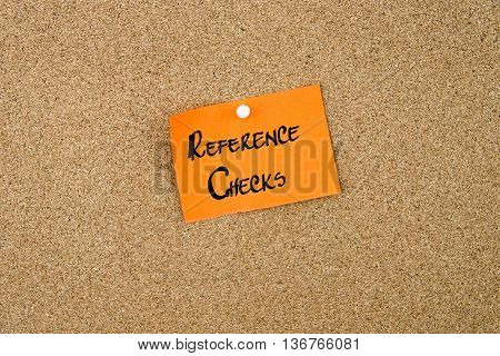 Reference Checks Written On Orange Paper Note