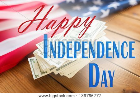 memorial day, patriotism and holiday concept - happy independence day words over american flag and dollar cash money background