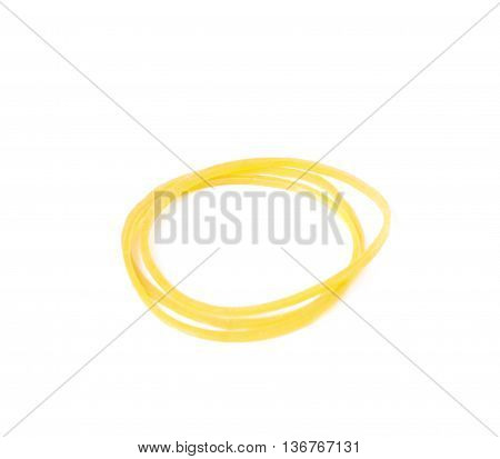 Pile of multiple office yellow rubber bands isolated over the white background