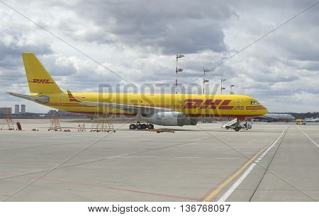 MOSCOW, RUSSIA - APRIL 15, 2015: Cargo plane TU-204C DHL on the parking lot in the airport Sheremetyevo