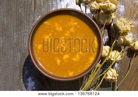 Caramel cream on wooden table. Delicious  caramel cream