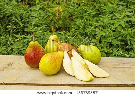 Pears on old wooden background. Pears on a rustic table