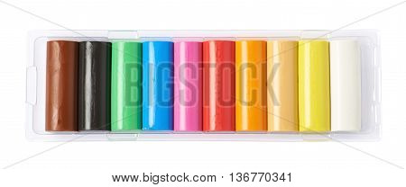 Multiple lined up sticks of colorful plasticine, composition isolated over the white background