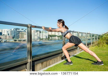 Woman doing warm up exercise at outdoor