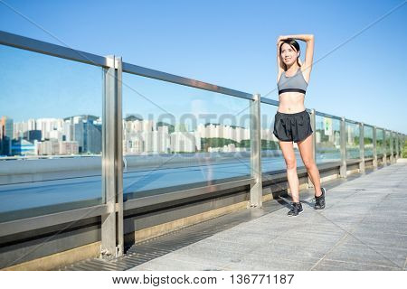 Woman  stretching her hand before run
