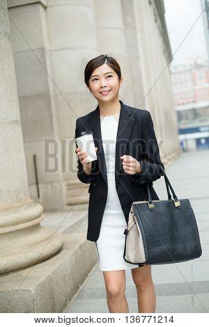Businesswoman walking at outdoor