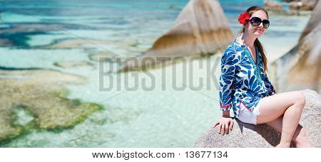 Woman Sitting On Top Of Granite Rock
