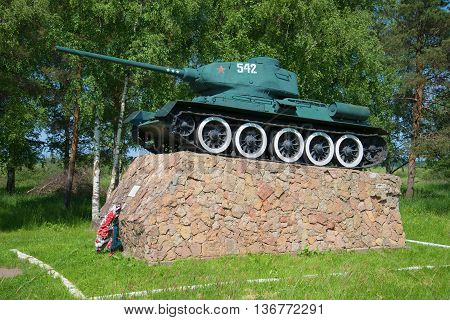 NOVGOROD REGION, RUSSIA - JUNE 02, 2016: Tank T-34-85 on the podium. The monument at the entrance to the city of Old Russa. Historical landmark of the Novgorod region
