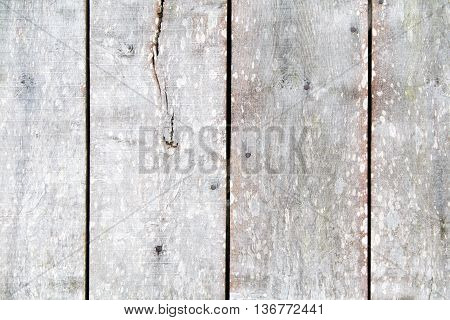 Wooden weathered texture of a section of an old barn door