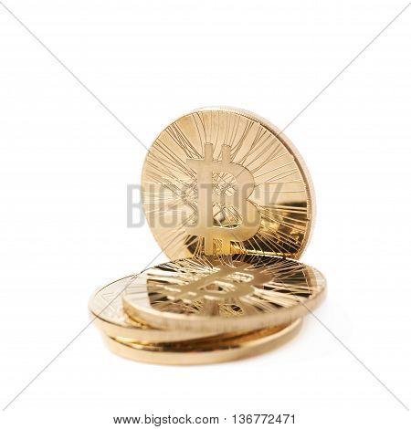 Pile of golden bitcoin currency tokens isolated over the white background