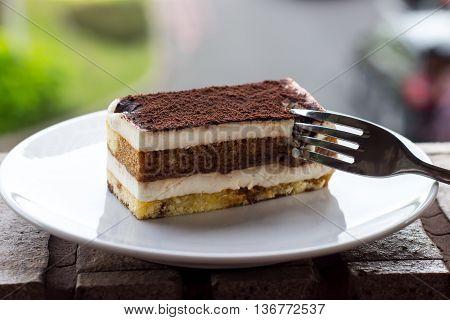 Tiramisu Cake. Tiramisu - Classical dessert with mascarpone and coffee