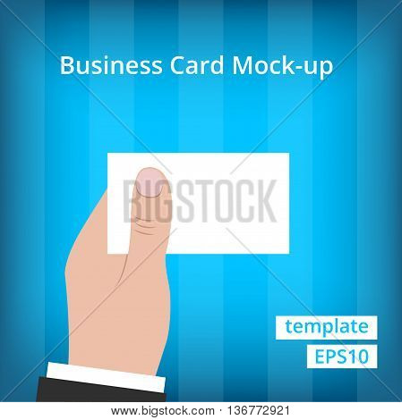 Business man in suit holding blank business card with one hand at blue background with stripes.