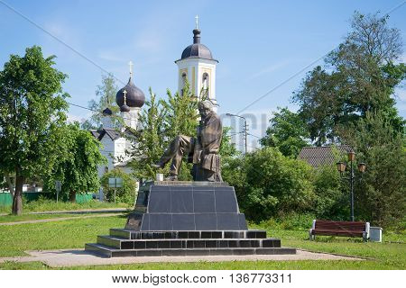 NOVGOROD REGION, RUSSIA - JUNE 02, 2016: The monument to F. M. Dostoevsky at the St. Nicholas Church on a sunny june day. Historical landmark of the city Staraya Russa, Russia
