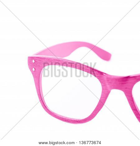 Pair of wooden textured optical reading glasses isolated over the white background, close-up crop foreshortening