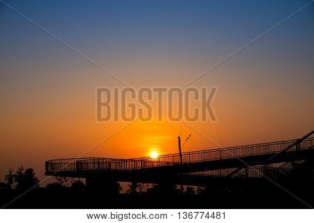 Overpass walk way silhouette. sky background and wallpaper