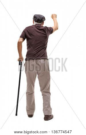 Full length rear view shot of a senior man knocking on a door isolated on white background