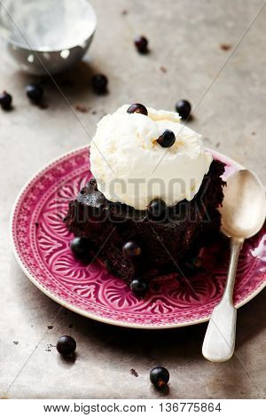 chocolate Brownie with ice cream and blackberry. selective focus.