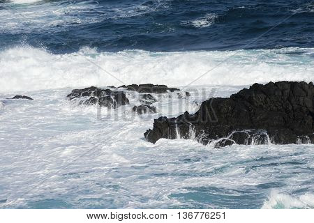 Waves, Water crashing over rocks in the sea