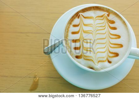 Caramel Macchiato Hot Of Coffee Drink On Wooden Table In The Cafe