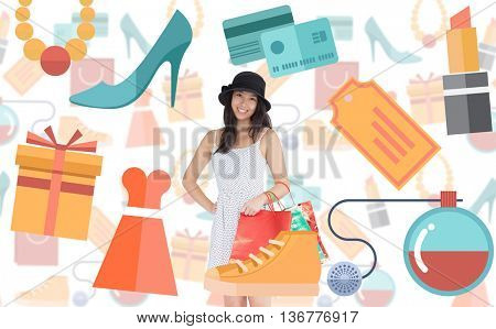Pretty woman with shopping bags against digital image of shopping doodles