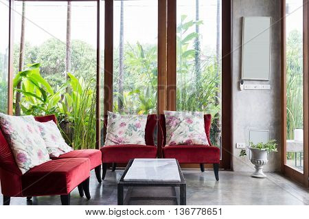 Design Of Interior Living Room Modern Style With Red Sofa Furniture In Green Garden