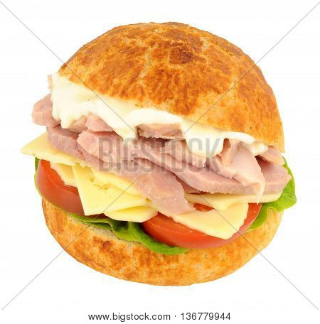 Chunky ham and cheese sandwich in a crusty bread roll with lettuce and tomato isolated on a white background
