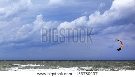 Power Kite In Sea And Cloudy Dark Sky