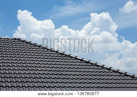 Black Tile Roof Of House With Blue Sky And Cloud Background