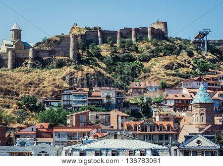 Tbilisi Georgia - July 18 2015. View of Church of Saint Nicholas (left) and ancient fortress Narikala on the hill above the oldest part of Tbilisi