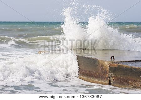 Sea Waves Breaking On The Concrete Pier