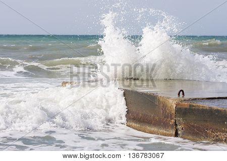 Sea Waves Breaking On The Concrete Pier