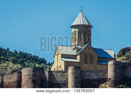 Tbilisi Georgia - July 18 2015. View of Church of Saint Nicholas (left) and walls of ancient fortress Narikala on the hill above the oldest part of Tbilisi
