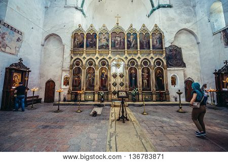 Ananuri Georgia - July 20 2015. Tourists visits Church of the Assumption located within the walls of Ananuri Castle