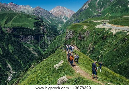 Caucasus Mountains Georgia - July 20 2015. Tourists walks near Soviet and Georgian Friendship monument near Guduari ski resort in Georgia in Caucasus Mountains