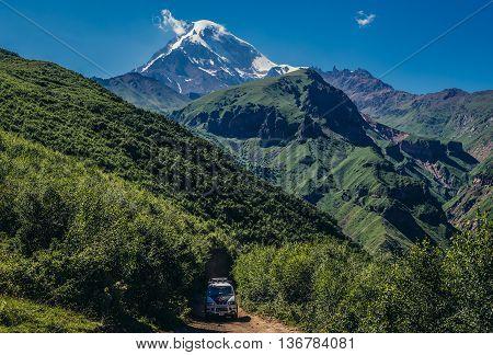 Gergeti Georgia - July 20 2015. View of Kazbek Mountain near Gergeti village in Caucasus Mountains Georgia