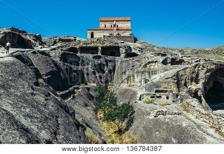 Uplistsikhe Georgia - July 21 2015. Christian Basilica in ancient rock-hewn town called Uplistsikhe in Georgia