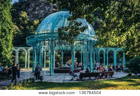 Borjomi Georgia - July 21 2015. Tourists nest to pavilion with mineral water fountain in Borjomi resort town famous for its mineral water industry