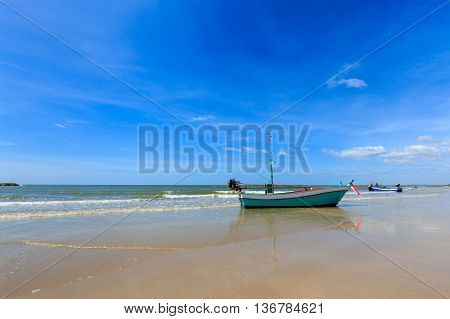 Small Fishing Boat At The Beach