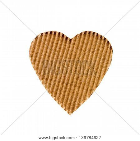 the symbol of a heart cut from corrugated cardboard isolated on white background. the concept of love Valentine's day
