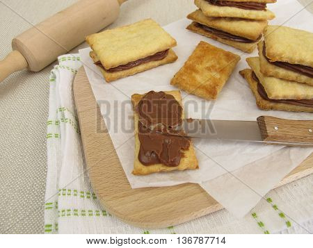 Homemade biscuit sandwiches filled with chocolate cream